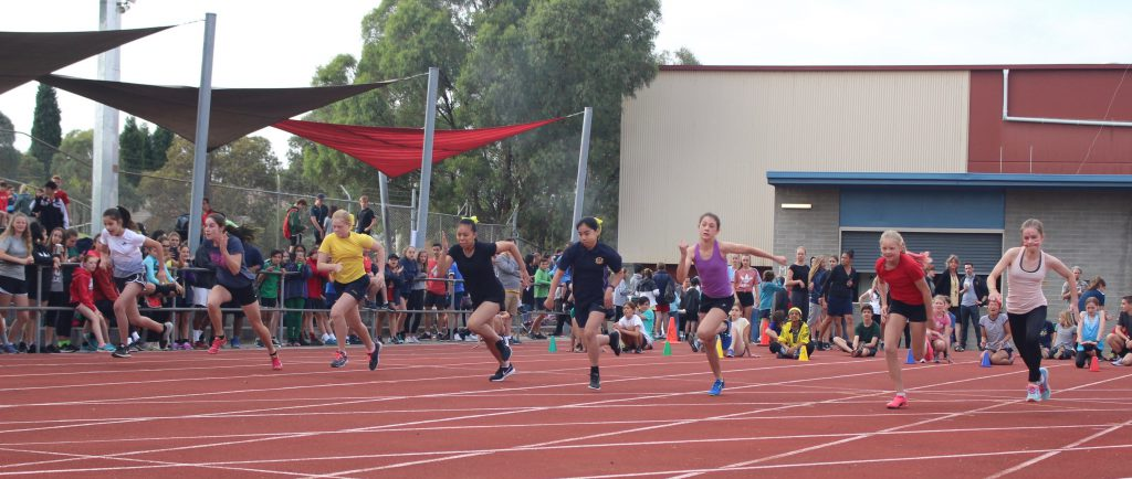 Students running at the annual sports carnival